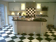 kitchen with black and white floor tiles